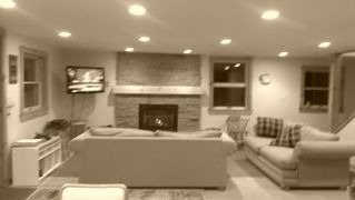 Mount Snow house photo - FIRST LEVEL ENTRY LIVING ROOM WITH GAS FIREPLACE