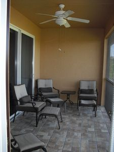 Tiled lanai with four chairs.
