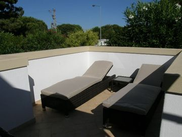 Sun loungers on private terrace