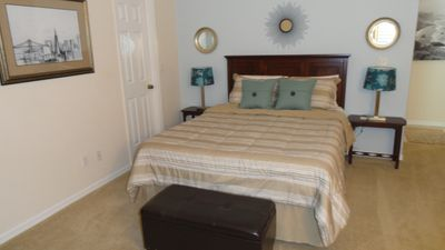 Master suite with queen bed, large custom walk-in closet, & bathroom.