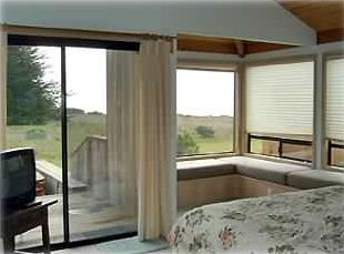 SEA RANCH RENTAL.  View inside Master Bedroom. Hot tub is outside sliding door.