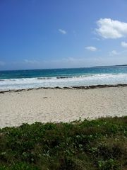 Orient Bay studio photo - Beach In Front Of Residence.