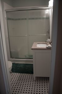 Delight in a walk-in shower with bench for your pleasure in this 2nd bath!
