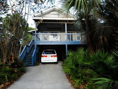 exterior of house showing deck and covered parking