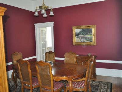 Dining room includes table with 6 chairs and expandable buffet for entertaining