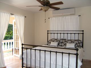 Rincon house photo - King bedroom w/ french doors to terrace. AC. 32 inch flat screen TV/DVD/Cable