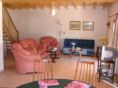 Spacious living area of Le Sapin with satellite TV