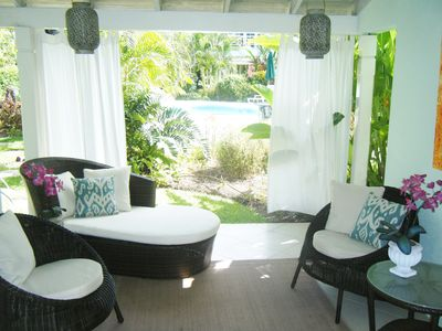 Peaceful relaxing covered patio with walk out to the pool behind