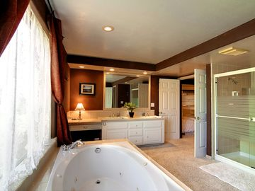 Two sinks, jacuzzi tub, dual headed shower and private toilet next to the bunks