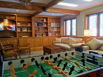 Killington house rental - The den has foosball, flat screen TV, games, books and sleeping for four