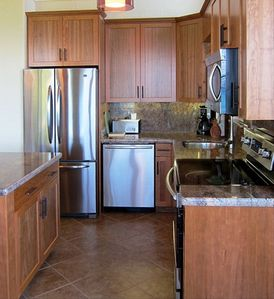 Stainless appliances, custom cabinets, granite counters, ample dishes & cookware