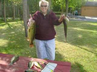 Walker cabin photo - Another satisfied renter and his catch!