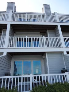 Deck and two large balconies with beautiful bay views; new siding, trex deck