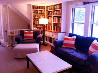 Marblehead apartment photo - Crow's Nest - Living room and reading material for use during your stay.