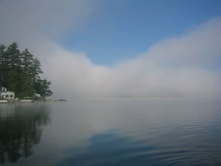 Lake Winnisquam cabin photo - Morning mist on the lake