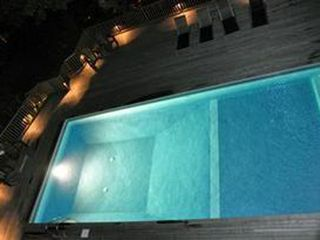Provincetown condo photo - Evening at the Pool. Water is kept warm enough to swim even on a cool Ptown eve.