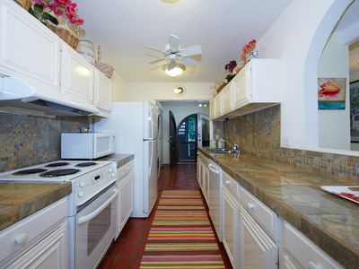 Fully equipped kitchen with full sized appliances, including a washer & dryer.