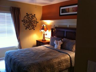 Master Bedroom with new bedding and flat screen tv