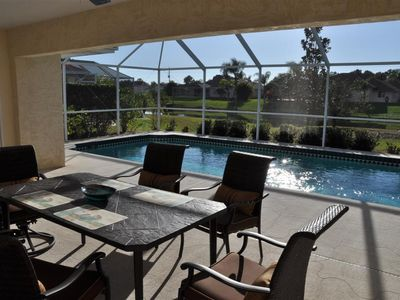 South Gulf Cove villa rental - Table and chairs to seat six on the spacious west facing lanai