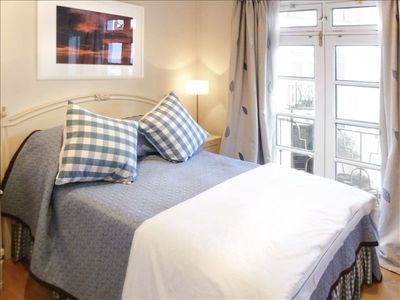 Bedroom two in french blue with double bed; location means quiet night's sleep!