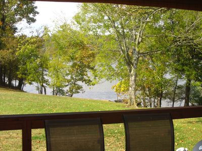 A view of our open, back lawn & the lake/ dock from the deck.