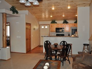 Show Low cabin photo - dining and kitchen bar with stools