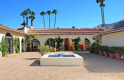 Palm Springs estate rental - courtyard with fountain. Main house in rear, guest house on left, garage on rig