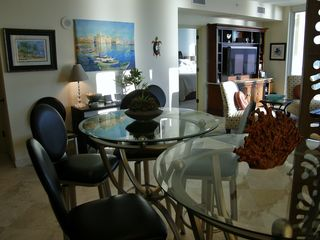Navarre Beach condo photo - Comfortable dining at glass-top tables and onyx breakfast bar.