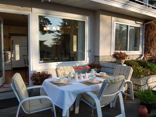 West Vancouver house photo - Outdoor dining for six with two lounge chairs and bar b q
