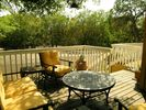 2 private decks with a gas barbecue and picnic table & umbrella on opposite side