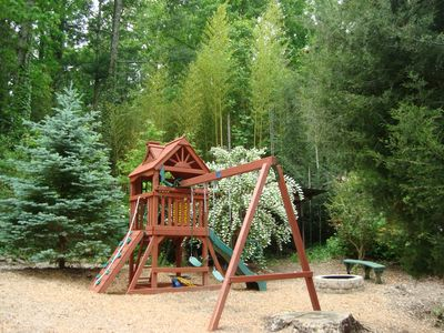 Kids love the playground slide, swings, fort & climbing wall. Firepit on right