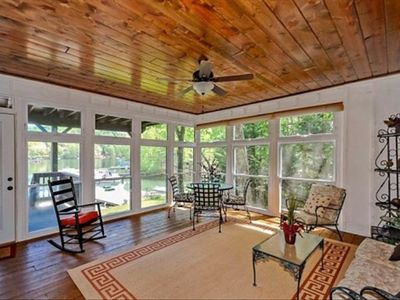 Screened in porch with view of lake.