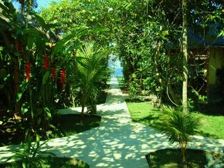 Walkway to ocean and ocean front cafe, less than one minute - Candidasa villa vacation rental photo