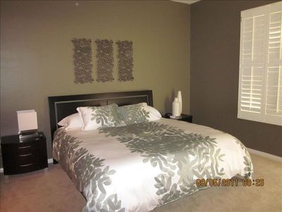 King bed with on-suite bath including spa tub, shower, 2 sinks and walk in close
