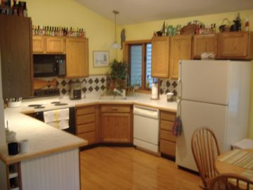 Kitchen -w/plenty of counter space and extendable table to seat 8-10