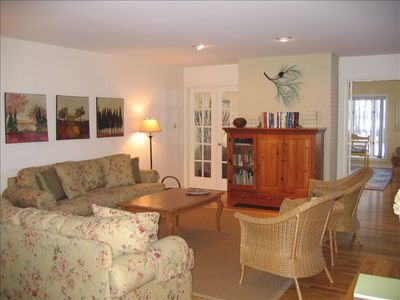 The living room flows directly into the Bay room, and is spacious and bright.