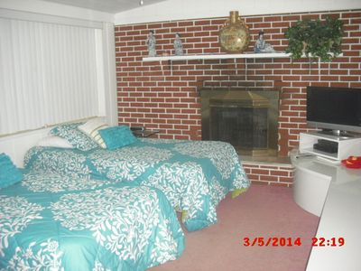 Twin beds on main floor just off kitchen & living room -- next to master bedroom