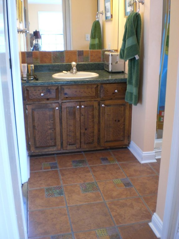 5' walk-in shower and enclosed toilet are to the right of sink