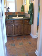 Tybee Island house photo - 5' walk-in shower and enclosed toilet are to the right of sink