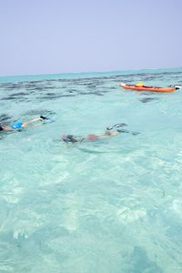snorkeling from the kayaks in the atoll