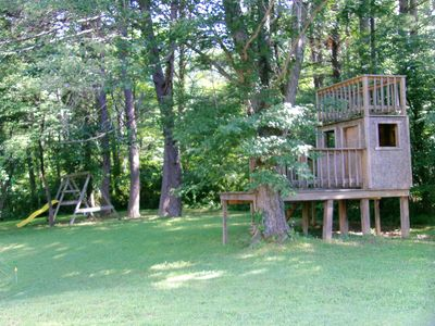 Big yard with swingset and clubhouse in side yard