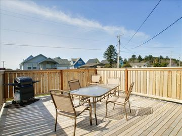 Large front deck, facing west, featuring gas BBQ and ample seating