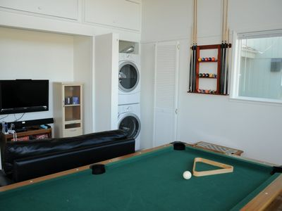 Pool table, washer and dryer, and electronic games (Wii) with sound system.