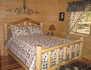Munising cottage photo - Master bedroom with Queen size bed and large flat screen TV.