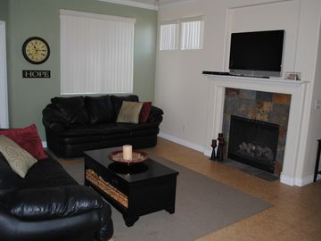 Mesa condo rental - Spacious living room, with two sofas, flat screen TV, cable, and DVD player.