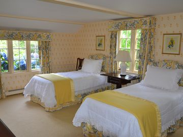 Another well appointed cottage bedroom, again, with a water view (sixth bedroom)