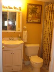 St Pete Beach condo photo - Bathroom with shower/tub condo and handicap rail