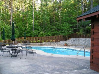 Seasonal pool area with bathrooms overlooks the lake. Pool passes are required.
