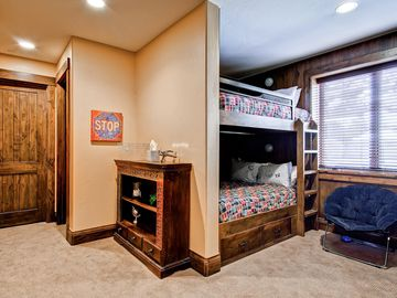 Lower level boy's bunk room - four queen beds with individual TV's
