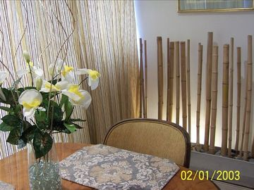 Dining room with new curtains & back lighted bambo wall